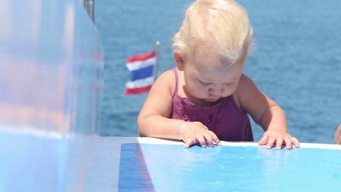 baby crawls deck ship ocean Stock Video Footage