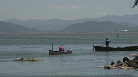 0124 Laguna , fishermen in boat in lake Stock Video Footage