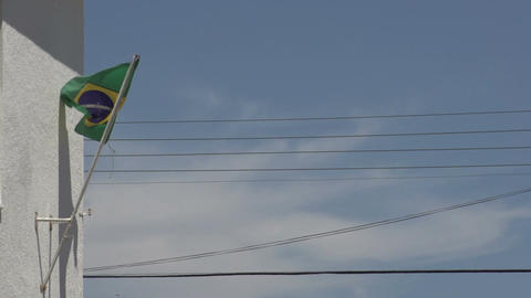0142 Flag of Brazil on building , bleu sky , elect Footage