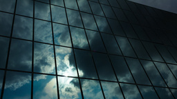 Glass Skyscraper Dark Clouds Reflection Timelapse stock footage