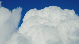 Puffy Cloud Against Blue Sky stock footage
