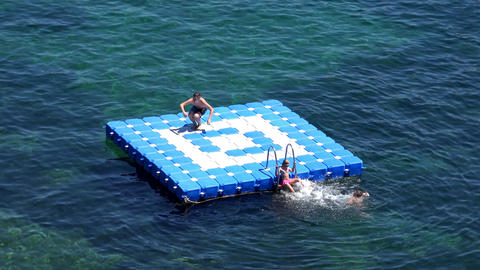 children play on an inflatable pontoon Footage