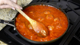 Stirring simmering meatballs Footage