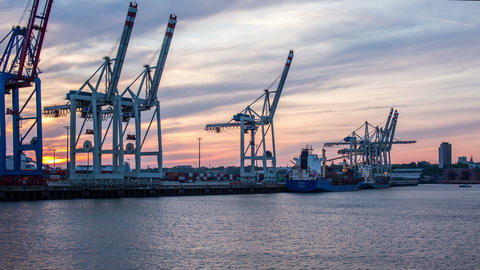 Hamburg harbor with unloading container ship - in Stock Video Footage