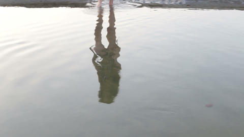 primitive woman in the reflection of the river Stock Video Footage