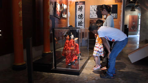 asian family in the puppet museum Stock Video Footage