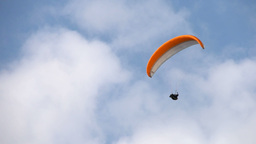 Paraglider Flying On A Sunny Day In Summer stock footage