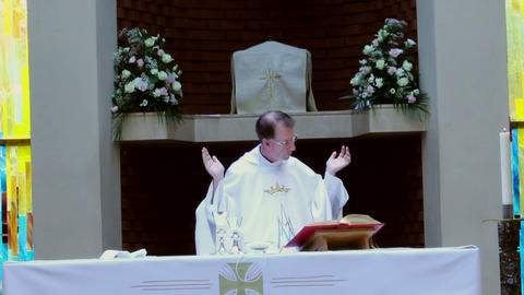 Catholic priest reads from the Bible during Mass Footage