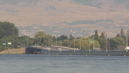 HD2009-8-1-11 Kelowna traffic on big bridge water traffic TL Footage