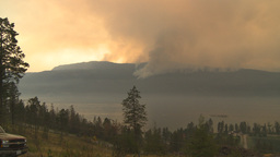 HD2009-8-1b-6 forest fire from across lake Footage