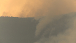 HD2009-8-1b-8 forest fire from across lake Stock Video Footage