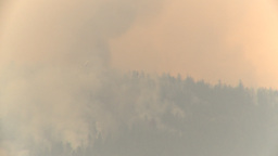 HD2009-8-1b-16 forest fire huey helicopter drop red... Stock Video Footage