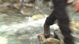 HD2009-8-6-2 hikers crossing creek Stock Video Footage