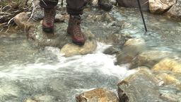 HD2009-8-6-2 hikers crossing creek Footage