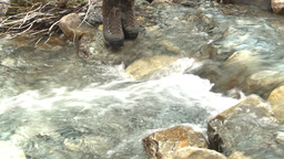 HD2009-8-6-2 hikers crossing creek Stock Video Footage