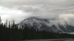 HD2009-8-8-6 clouds tearingalong mtn side Z to highway Stock Video Footage