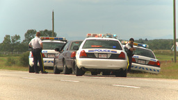 HD2009-8-9-2 many police cars on highway Footage