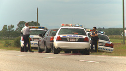 HD2009-8-9-2 many police cars on highway Stock Video Footage