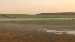 HD2009-8-20-21 light fog on field hay rolls Stock Video Footage