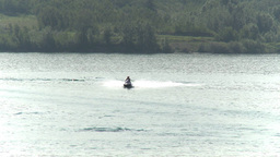 HD2009-8-22RC-7 seadoo on lake 2people Stock Video Footage