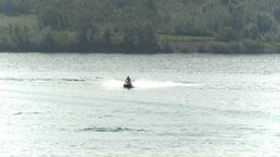 HD2009-8-22RC-7 seadoo on lake 2people Stock Video Footage