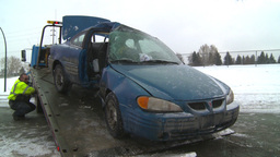 HD2009-2-1-6 auto accident car onto tow truck Stock Video Footage