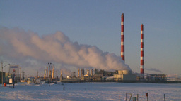 HD2009-2-1-26 Gas plant at sunrise stacks Stock Video Footage