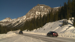 HD2009-1-7-18 snow mtn highway car Stock Video Footage