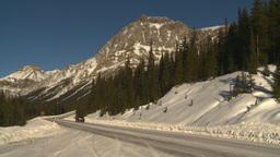 HD2009-1-7-18 snow mtn highway car Stock Video Footage