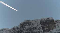 HD2009-1-8-28 jet contrail mtn top disappear Stock Video Footage
