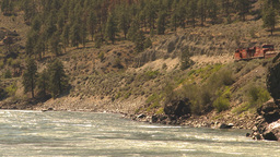 HD2009-7-2-2 frieght train above whitewater river Stock Video Footage