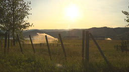 HD2009-7-2-4 irrigation in farm field evening, barb wire Stock Video Footage