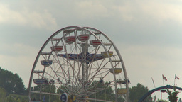 HD2009-7-3-22 midway aerial skyline ride 3 shot Stock Video Footage