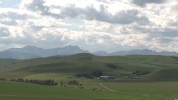 HD2009-7-10-6RC clouds and foothills ranch med TL Stock Video Footage