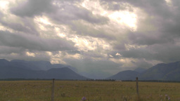 HD2009-7-15-3 TL clouds over mtns and valley sunrays Stock Video Footage