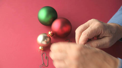 Untangling Christmas Ornament Hooks stock footage