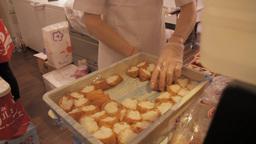 Inarizushi, stuffed tofu skin sushi being prepared Footage