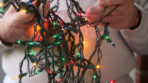 untangling Christmas lights Footage