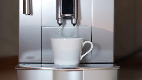 Coffee maker pouring hot water Footage