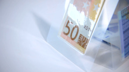 Close Up Of Folded And Foiled Euro Banknotes Stand stock footage