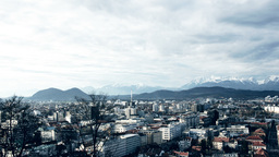 4K - Timelapse Ljubljana Cityscape And Mountains stock footage