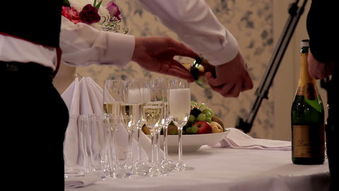 Waiter Pouring Champagne on Empty glasses Footage