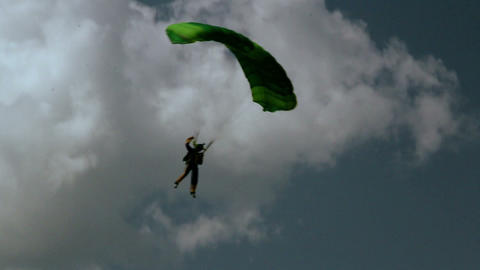 A person on the green parachute is about to land Footage