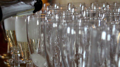 Waiter is pouring Champagne on Empty Glasses Footage