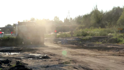 A dump truck after unloading and leaving the site  Footage
