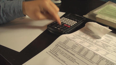 Young Accountant Hands Calculating Taxes Late At N Live Action