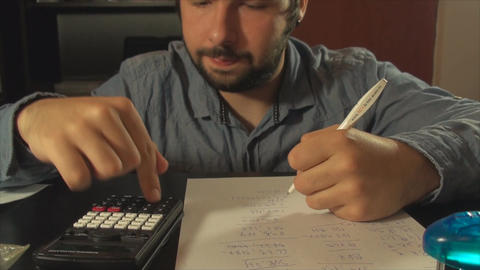 Young Accountant Calculating Taxes Late At Night,  Footage