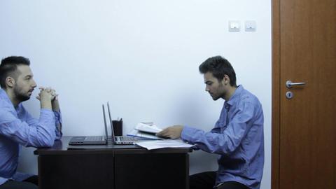 Students Working In Internship, Looking At Documen Footage