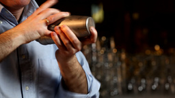 Bartender MIxing Drink In Cocktail Shaker stock footage