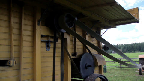 The home made old time noisy farm machine Footage